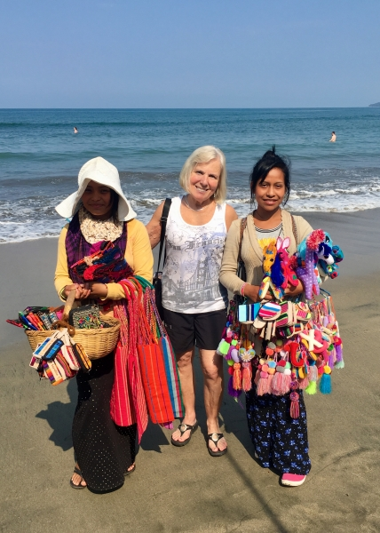Beach vendors with handmade items.